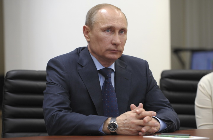 Russian President Vladimir Putin looks on during his visit to a financial crime monitoring centre in Moscow