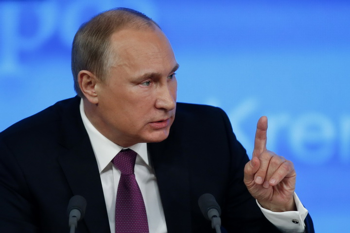 Russian President Putin gestures during his annual end-of-year news conference in Moscow