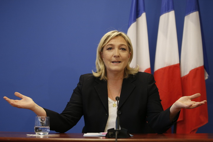 France's National Front political party head Marine Le Pen speaks during a news conference at the party headquarters in Nanterre near Paris