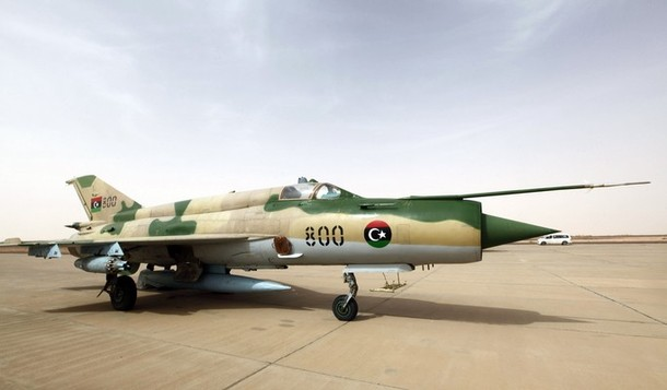 MiG fighter aircraft is seen parked on the runway at Tammahint